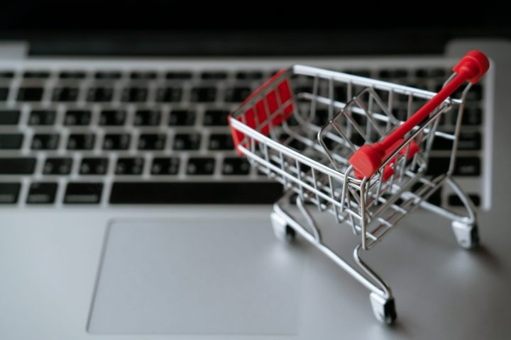 shopping cart on laptop, online shopping concept